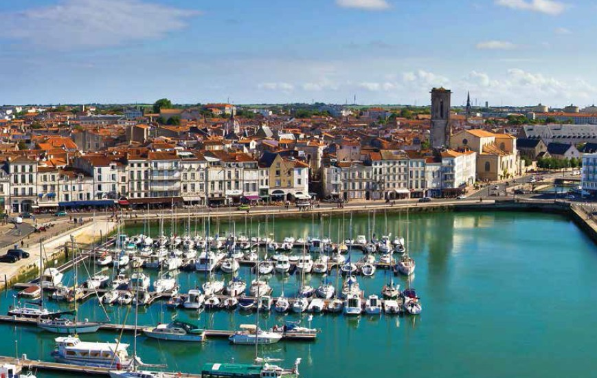 La Rochelle Port has some of the most beautiful scenery in France. Numerous yachts are docked here and a beach is located right beside the port