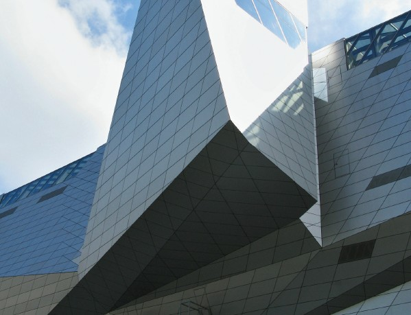 The modern building of Musée des Confluences hides a controversial story about its construction
