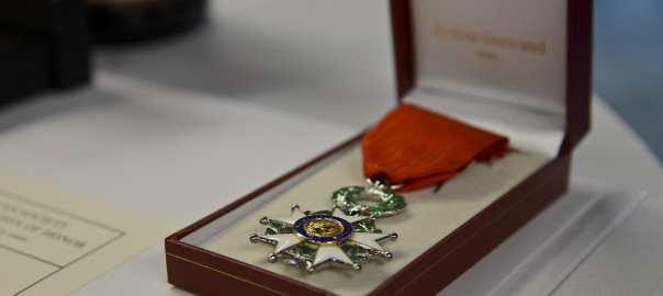The French Legion D'Honneur, the highest decoration in France, lies on a table at a French National Day celebration in Tampa, Florida, July 14, 2014. Four World War II veterans received the medal for their service during the war. (U.S. Air Force photo by Airman 1st Class Ned T. Johnston/Released)