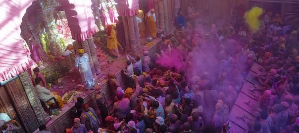 People throwing colours at the Portrait  of Lord Krishna at the Banke Bihari temple