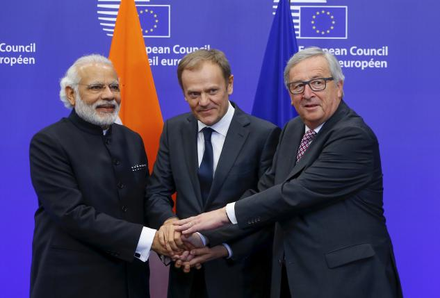 India's Prime Minister Narendra Modi (L) is welcomed by European Council President Donald Tusk (C) and European Commission President Jean-Claude Juncker at the EU-India Summit in Brussels, Belgium