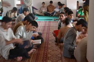 Muslim boys reciting holy Quran in a mosque. MIG:Ahmad Mukhtiyar
