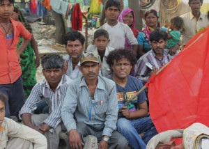 Abdul Shakeel Campaign coordinator at HLRN in the center with the homeless people at Mayur Vihar Phase 1