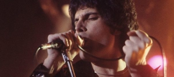 Freddie Mercury in his younger days, known for his spectacular stage presence and exhilarating vocal performances.