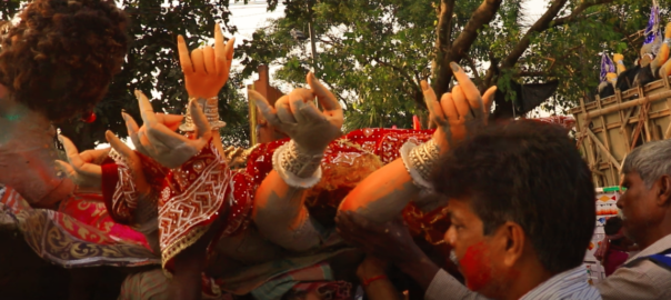 People carrying the goddess to the river.