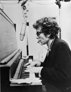 Dylan's first professional recording was as a harmonica player at a Harry Belafonte session.