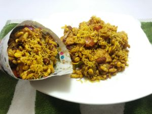 olive-bhel-puri-served-in-traditional-newspaper-cone
