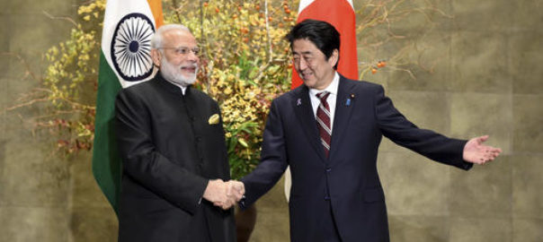 Indian Prime Minister Narendra Modi, left, is welcomed by his Japanese counterpart Shinzo Abe upon his arrival for their meeting at Abe's official residence in Tokyo, Friday, Nov. 11, 2016. Modi is visiting Japan on a three-day visit. (Toru Yamanaka/Pool Photo via AP)