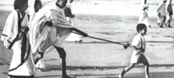File Picture: Young Kanu Gandhi pulls Mahatma Gandhi's stick during the famous Dandi March (Salt Satyagraha)