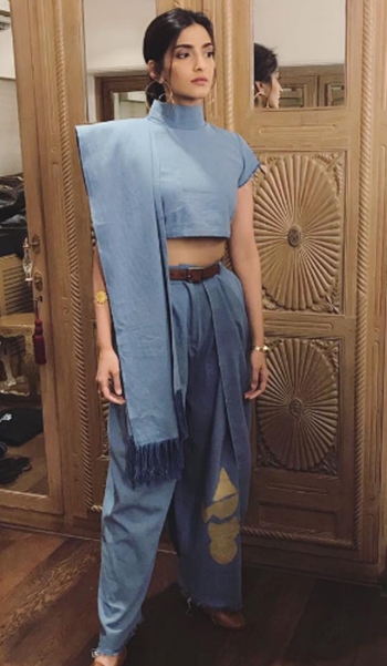 Bollywood actress Sonam Kapoor in her denim dhoti saree paired with a belt