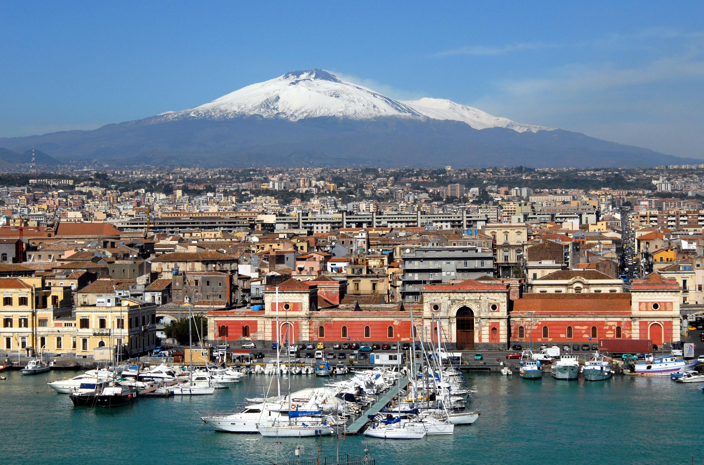 Catania, an ancient port city on Sicily's east coast, sits at the foot of Mt. Etna, an active volcano with trails leading up to the summit