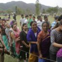 People stand in line to cast their votes at a voting center in Kalapahar, Manipur state, India, Wednesday, April 9, 2014. Hundreds of thousands of people in long-winding lines voted Wednesday in the insurgency-wracked remote northeast of India in the second phase of the county's national elections. The multiphase voting across the country runs until May 12, with results for the 543-seat lower house of parliament announced May 16. (AP Photo/Anupam Nath)