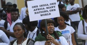 A picture from a protest from last year when a Tanzanian woman was attacked in Bengaluru. Many such incidents have occurred in India recently. Photo Credit: PTI