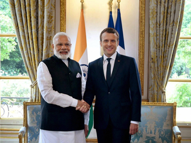 Indian Prime Minister Narendra Modi meets French President Emmanuel Macron on the last leg of his four nation tour of Europe (Photo: PTI)