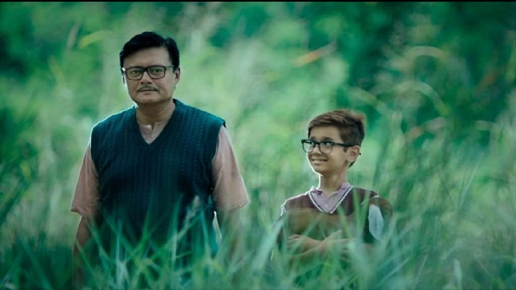 Saswata Chatterjee with young Jagga in a still from the film