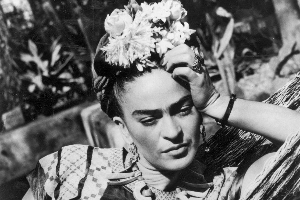 Frida Kahlo, posing for a photograph