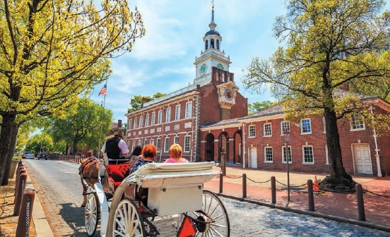 Enjoying a horse cart ride near the Independence Hall in Philadelphia;