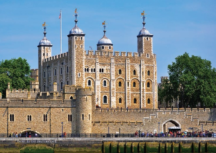 Tower of London, the most famous landmark of the city, stands across the Tower Bridge