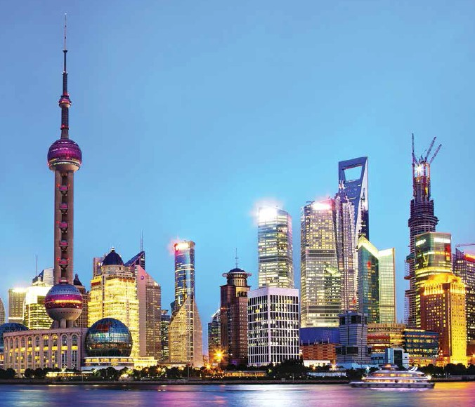 At the Bund, dozens of historical buildings light up at night to make a dazzling spectacle