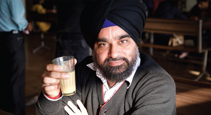 A sikh man enjoying his tea at a dhaba on the way to Chandigarh