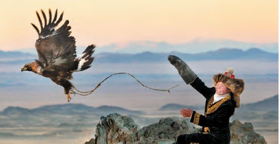 Mongolian girl practicing the centuries-old tradition of hunting with eagles