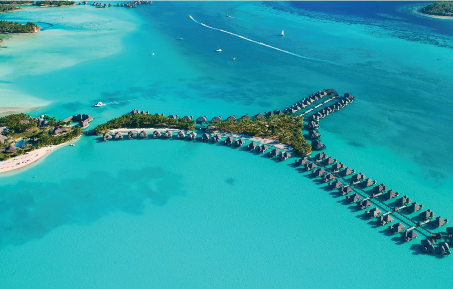 Aerial shot of overwater bungalows in Bora Bora, a perfect vacation destination in French Polynesia's Leeward Islands
