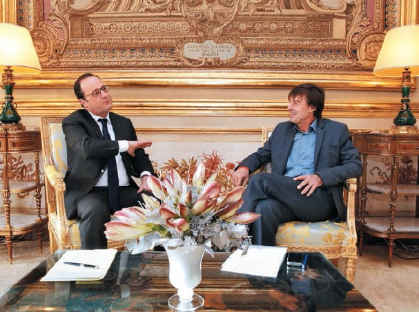 Igniting minds: Nicolas Hulot (right) in discussion with French President François Hollande