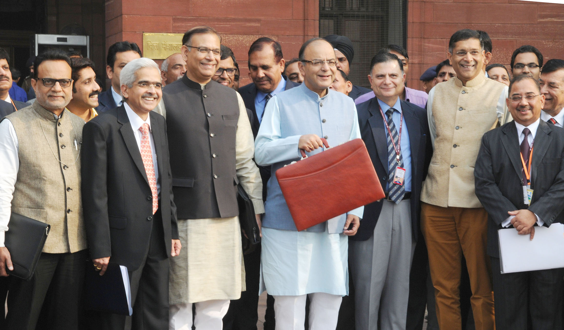 The Union Minister for Finance, Corporate Affairs and Information & Broadcasting, Shri Arun Jaitley departs from North Block to Parliament House along with the Minister of State for Finance, Shri Jayant Sinha to present the General Budget 2016-17, in New Delhi on February 29, 2016. The Secretary, Department of Economic Affairs, Ministry of Finance, Shri Shaktikanta Das, the Secretary, Revenue, Dr. Hasmukh Adhia and the Chief Economic Adviser, Dr. Arvind Subramanian are also seen.