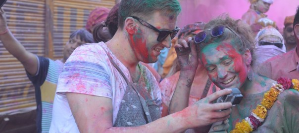 Tourist enjoying holi on the streets of Mathura and getting pictures clicked