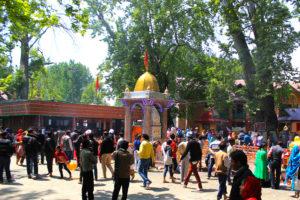 Devotees surrounding the temple