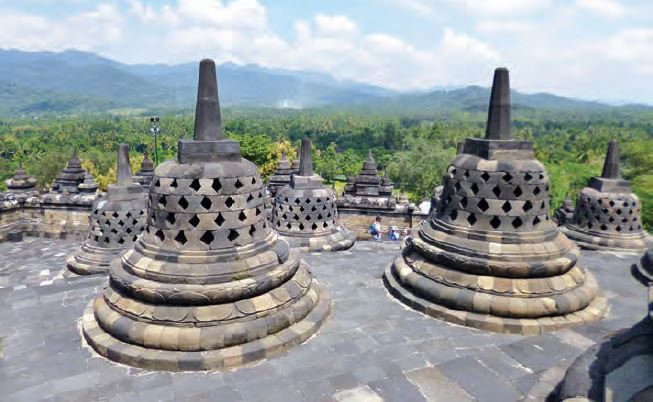 Borobudur stupas overlooking a mountain. For centuries it was deserted