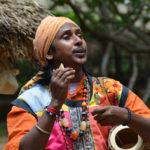 A baul singer plays a typical folk instrument