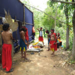 Backstage: Tribal theatre artists preparing for a hunting scene
