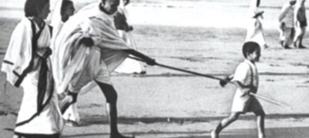 File Picture: Young Kanu Gandhi pulls Mahatma Gandhi's stick during the famous Dandi March (Salt Satyagraha)