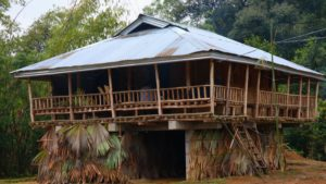Previously made entirely of bamboo, huts in Basar are taking to the use of tin and other materials