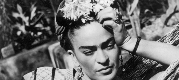 Frida Kahlo, posing for a photograph