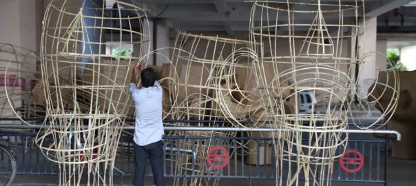 The artists work day and night to create huge structures with bamboo sticks