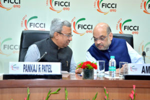 Pankaj Patel, President of FICCI with Amit Shah, President of BJP during the interactive session at FICCI, New Delhi