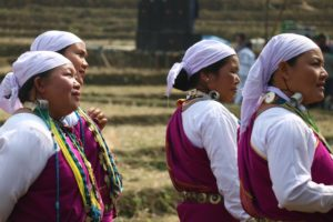 Tribal women dressed up to perform dances and chants during the Mopin festival at Basar earlier this year