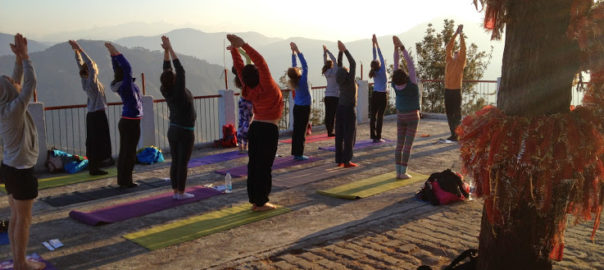 Participants performing special early morning yoga session in the International Yoga and Music Festival at the Kunajapuri Temple, Uttarakhand