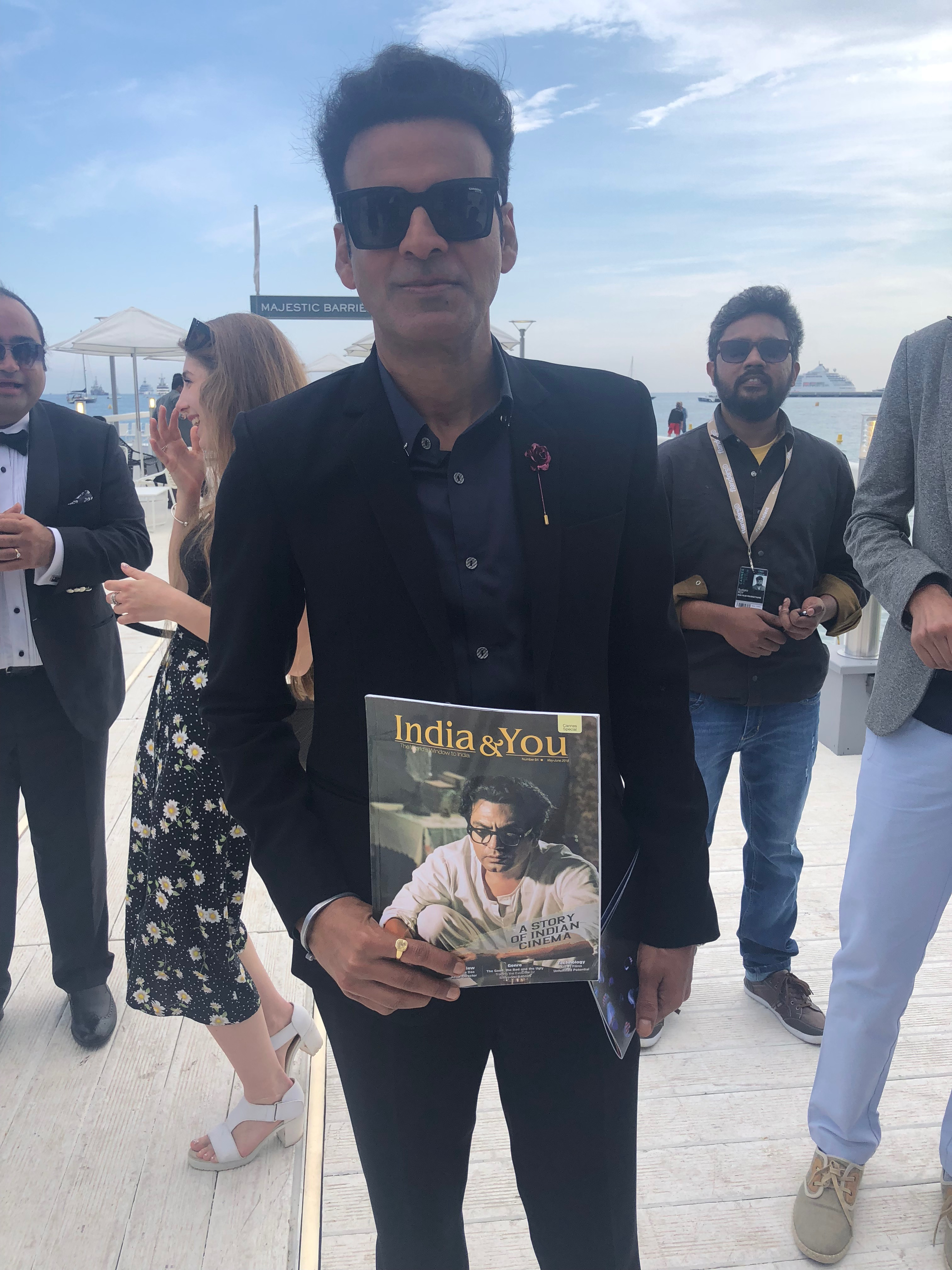 Manoj Bajpayee with the Cannes Film Festival special issue of the India & You magazine by Media India Group