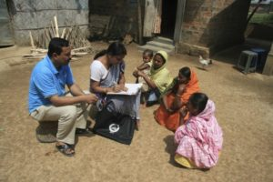 Census officials collecting details from villagers