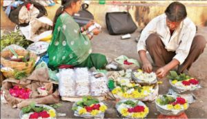 Flowers for offering to the lord being sold outside the Jagannath Temple in Odisha