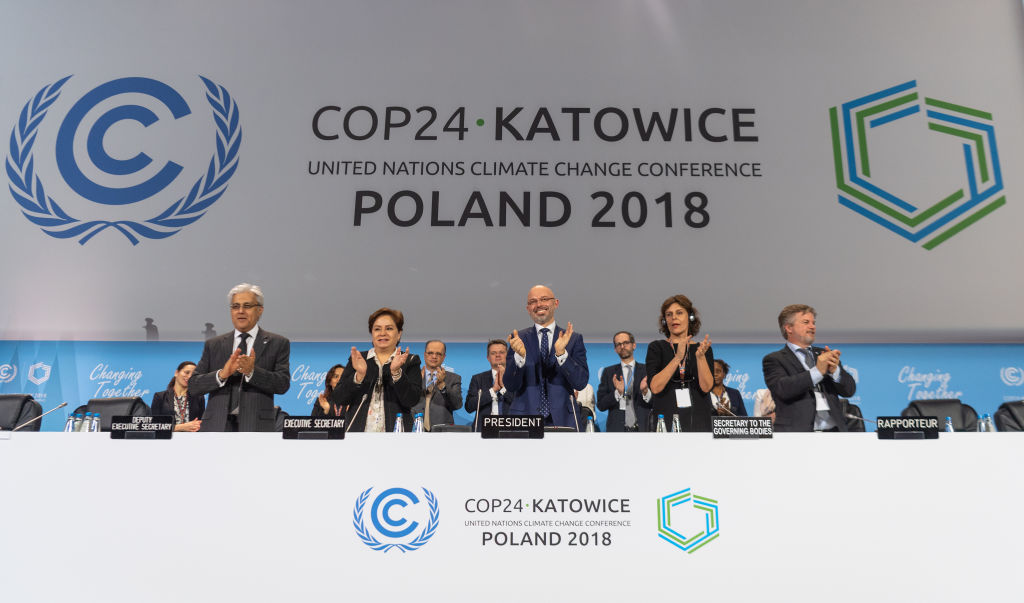15 December 2018, Poland, Katowice: Michal Kurtyka (M), President of the UN Climate Change Conference COP24, and other participants of the climate summit are pleased about the decision of the compromise at the world climate summit. The aim of the agreement is to limit global warming to well below two degrees. Photo: Monika Skolimowska/dpa-Zentralbild/dpa (Photo by Monika Skolimowska/picture alliance via Getty Images)