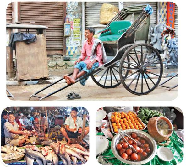 Handgezogene Rikschas existieren noch auf den Straßen Kolkatas; der Hatibagan Markt;Süßwaren sind ein wesentlicher Bestandteil von Durga Puja