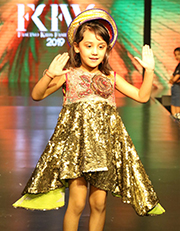 The kids walking down the ramp wore elegance and innocence on their sleeves