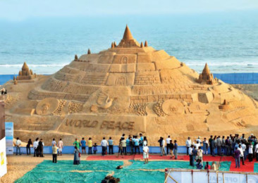 Sand Sculpting By The Sea Shore