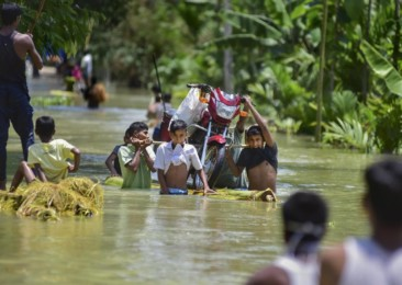 Floods overwhelm pandemic-hit Assam