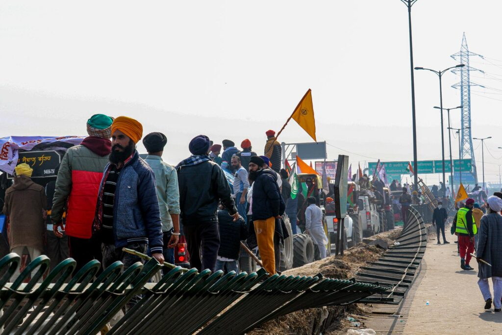 protestors break road divider