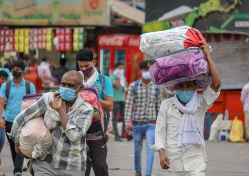 Anticipating prolonged lockdown, migrant workers flee again in repeat of 2020